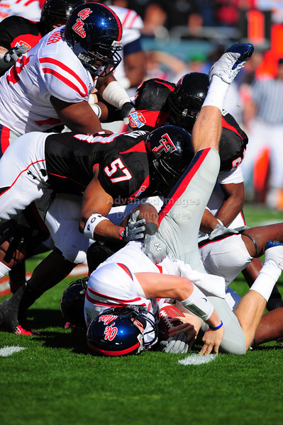 02 January 2009:  <br /> Texas Tech linebacker Brian Duncan (57)<br /> Mississippi quarterback Jevan Snead (4)<br /> in action during the NCAA Cotton Bowl game between the Ole Miss Rebels and the Texas Tech Red Raiders in Dallas,TX.  Ole Miss beat Texas Tech 47-34.<br /> Manny Flores/Icon SMI