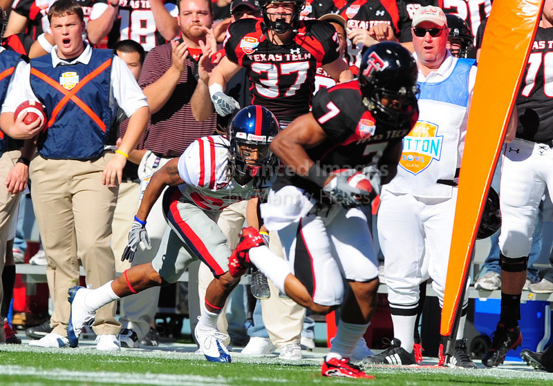 02 January 2009:  <br /> Texas Tech safety Darcel McBath (7) gets an interceptioin and takes scores a touchdown during the NCAA Cotton Bowl game between the Ole Miss Rebels and the Texas Tech Red Raiders in Dallas,TX.  Ole Miss beat Texas Tech 47-34.<br /> Manny Flores/Icon SMI