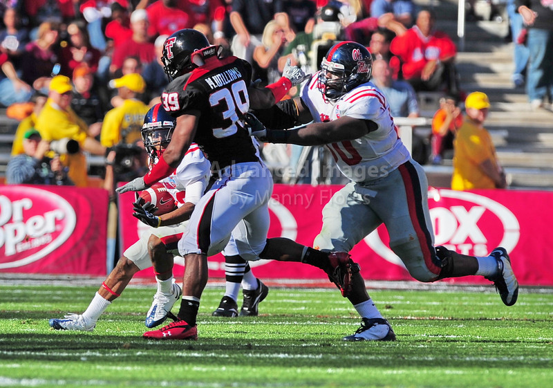 02 January 2009:  <br /> Texas Tech linebacker Marlon Williams (39) & Mississippi offensive lineman Darryl Harris (50) in action during the NCAA Cotton Bowl game between the Ole Miss Rebels and the Texas Tech Red Raiders in Dallas,TX.  Ole Miss beat Texas Tech 47-34.<br /> Manny Flores/Icon SMI