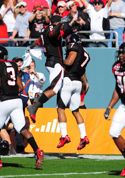 02 January 2009:  <br /> Texas Tech safety Darcel McBath (7) &  Texas Tech running back Shannon Woods (2) celebrate a touchdown during the NCAA Cotton Bowl game between the Ole Miss Rebels and the Texas Tech Red Raiders in Dallas,TX.  Ole Miss beat Texas Tech 47-34.<br /> Manny Flores/Icon SMI