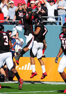 02 January 2009:   Texas Tech safety Darcel McBath (7) &  Texas Tech running back Shannon Woods (2) celebrate a touchdown during the NCAA Cotton Bowl game between the Ole Miss Rebels and the Texas Tech Red Raiders in Dallas,TX.  Ole Miss beat Texas Tech 47-34. Manny Flores/Icon SMI