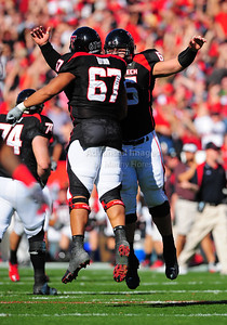 02 January 2009:   Texas Tech offensive lineman Marlon Winn (67) & Texas Tech offensive lineman Louis Vasquez (65)i celebrate a touchdown during the NCAA Cotton Bowl game between the Ole Miss Rebels and the Texas Tech Red Raiders in Dallas,TX.  Ole Miss beat Texas Tech 47-34. Manny Flores/Icon SMI