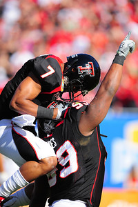 02 January 2009:   Texas Tech defensive tackle Richard Jones (99) and Texas Tech quarterback Seth Doege (7) in action during the NCAA Cotton Bowl game between the Ole Miss Rebels and the Texas Tech Red Raiders in Dallas,TX.  Ole Miss beat Texas Tech 47-34. Manny Flores/Icon SMI