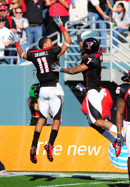 02 January 2009:  <br /> Texas Tech safety Darcel McBath (7) & Texas Tech wide receiver Tramain Swindall (11) celebrate a touchdown during the NCAA Cotton Bowl game between the Ole Miss Rebels and the Texas Tech Red Raiders in Dallas,TX.  Ole Miss beat Texas Tech 47-34.<br /> Manny Flores/Icon SMI