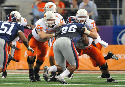 Jan 2nd, 2009  Oklahoma State offensive lineman Andrew Lewis #54 & Oklahoma State offensive lineman Noah Franklin #77 at the 2010 AT&T Cotton Bowl Classic between the Ole Miss Rebels and the Oklahoma State Cowboys at the Cowboy Stadium in Arlington, Texas. Ole Miss wins 21-7 (Credit Image: © Manny Flores/Cal Sport Media)