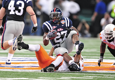 Jan 2nd, 2009  Mississippi running back Enrique Davis #27 is tackled by Oklahoma State linebacker Patrick Lavine #4 at the 2010 AT&T Cotton Bowl Classic between the Ole Miss Rebels and the Oklahoma State Cowboys at the Cowboy Stadium in Arlington, Texas. Ole Miss wins 21-7 (Credit Image: © Manny Flores/Cal Sport Media)