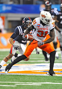 Jan 2nd, 2009  Oklahoma State safety Lucien Antoine #31 gets an interception at the 2010 AT&T Cotton Bowl Classic between the Ole Miss Rebels and the Oklahoma State Cowboys at the Cowboy Stadium in Arlington, Texas. Ole Miss wins 21-7 (Credit Image: © Manny Flores/Cal Sport Media)