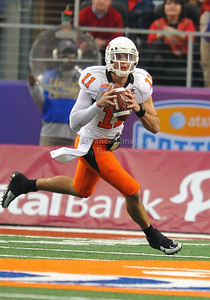 Jan 2nd, 2009  Oklahoma State quarterback Zac Robinson #11 scrambles at the 2010 AT&T Cotton Bowl Classic between the Ole Miss Rebels and the Oklahoma State Cowboys at the Cowboy Stadium in Arlington, Texas. Ole Miss wins 21-7 (Credit Image: © Manny Flores/Cal Sport Media)