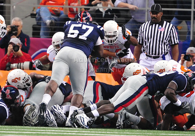 Jan 2nd, 2009  Mississippi offensive lineman Chris Gill #67 tries to run the ball in from the one yard line and is stopped by Oklahoma State linebacker Donald Booker #44 at the 2010 AT&T Cotton Bowl Classic between the Ole Miss Rebels and the Oklahoma State Cowboys at the Cowboy Stadium in Arlington, Texas. Ole Miss wins 21-7 (Credit Image: © Manny Flores/Cal Sport Media)