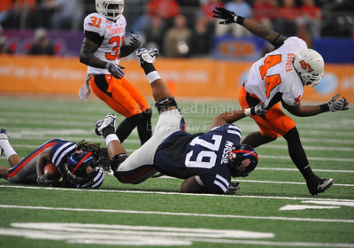 Jan 2nd, 2009  Oklahoma State linebacker Donald Booker #44 is pulled down by Oklahoma State defensive tackle Andrew Smith #79 at the 2010 AT&T Cotton Bowl Classic between the Ole Miss Rebels and the Oklahoma State Cowboys at the Cowboy Stadium in Arlington, Texas. Ole Miss wins 21-7 (Credit Image: © Manny Flores/Cal Sport Media)