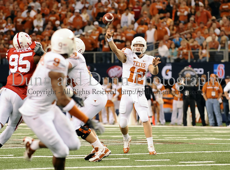 Texas quarterback Colt McCoy throws a pass to wide receiver Malcolm Williams.