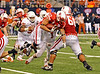 Nebraska running back Roy Helu (#10) is knocked off his feet after a short gain.