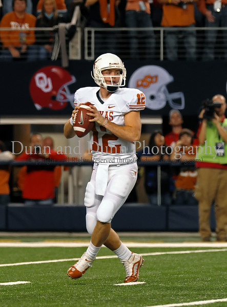 Colt McCoy looks for an open receiver.