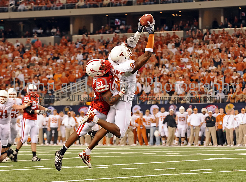 Texas wide receiver Malcolm WIlliams (#9) catches a Colt McCoy pass for a first down.  Defending on the play is Prince Amukamara (#21).