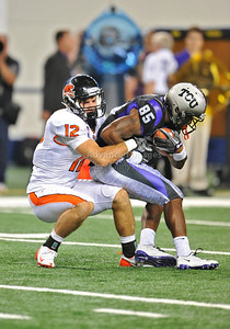 Sept 4 2010:   Oregon State Beavers safety Dax Dilbeck #12 tackles TCU Horned Frogs wide receiver Jeremy Kerley #85 in a game between Oregon State Beavers vs Texas Christian University Frogs at Cowboys Stadium in Arlington, Texas. TCU wins 30-21 (Credit Image: © Manny Flores/Cal Sport Media)