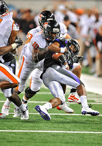 Sept 4 2010:   Oregon State Beavers safety Lance Mitchell #10 stops TCU Horned Frogs wide receiver Skye Dawson #11 short of a first down in a game between Oregon State Beavers vs Texas Christian University Frogs at Cowboys Stadium in Arlington, Texas. TCU wins 30-21 (Credit Image: © Manny Flores/Cal Sport Media)