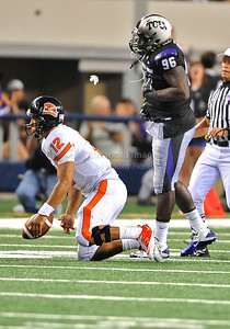 Sept 4 2010:   TCU Horned Frogs defensive end Wayne Daniels #96 dives and tackles Oregon State Beavers quarterback Ryan Katz #12 for a sack in a game between Oregon State Beavers vs Texas Christian University Frogs at Cowboys Stadium in Arlington, Texas. TCU wins 30-21 (Credit Image: © Manny Flores/Cal Sport Media)