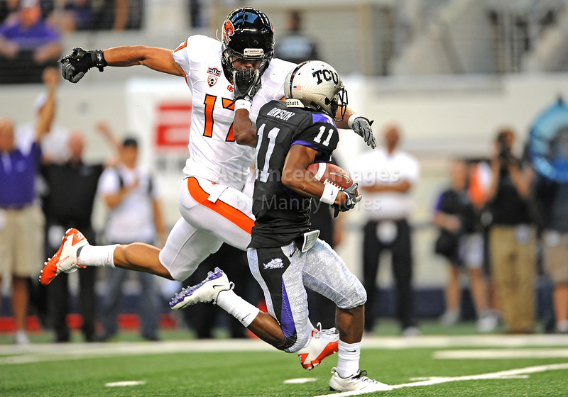 Sept 4 2010:  <br /> TCU Horned Frogs wide receiver Skye Dawson #11 stiff arms Oregon State Beavers cornerback Brandon Hardin #17 in a game between Oregon State Beavers vs Texas Christian University Frogs at Cowboys Stadium in Arlington, Texas.<br /> TCU wins 30-21<br /> (Credit Image: © Manny Flores/Cal Sport Media)