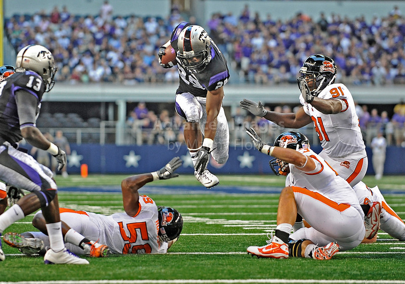 04 Sept 2010:  <br /> TCU Horned Frogs running back Matthew Tucker #29 leaps into the air in a game between the Oregon State Beavers vs TCU Horned Frogs at Cowboy Stadium in Arlington Texas.<br /> TCU wins 30-21