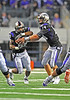 04 Sept 2010:  <br /> TCU Horned Frogs quarterback Andy Dalton #14 hands off to TCU Horned Frogs running back Matthew Tucker #29 in a game between the Oregon State Beavers vs TCU Horned Frogs at Cowboy Stadium in Arlington Texas.<br /> TCU wins 30-21
