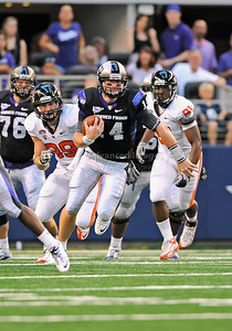Sept 4 2010:   TCU Horned Frogs quarterback Andy Dalton #14 runs for a 1st down in a game between Oregon State Beavers vs Texas Christian University Frogs at Cowboys Stadium in Arlington, Texas. TCU wins 30-21 (Credit Image: © Manny Flores/Cal Sport Media)