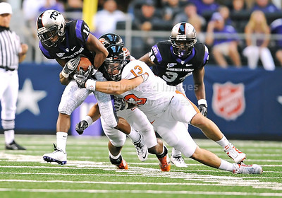 Sept 4 2010:   Oregon State Beavers linebacker Rueben Robinson #13 tackles TCU Horned Frogs wide receiver Skye Dawson #11 in a game between Oregon State Beavers vs Texas Christian University Frogs at Cowboys Stadium in Arlington, Texas. TCU wins 30-21 (Credit Image: © Manny Flores/Cal Sport Media)