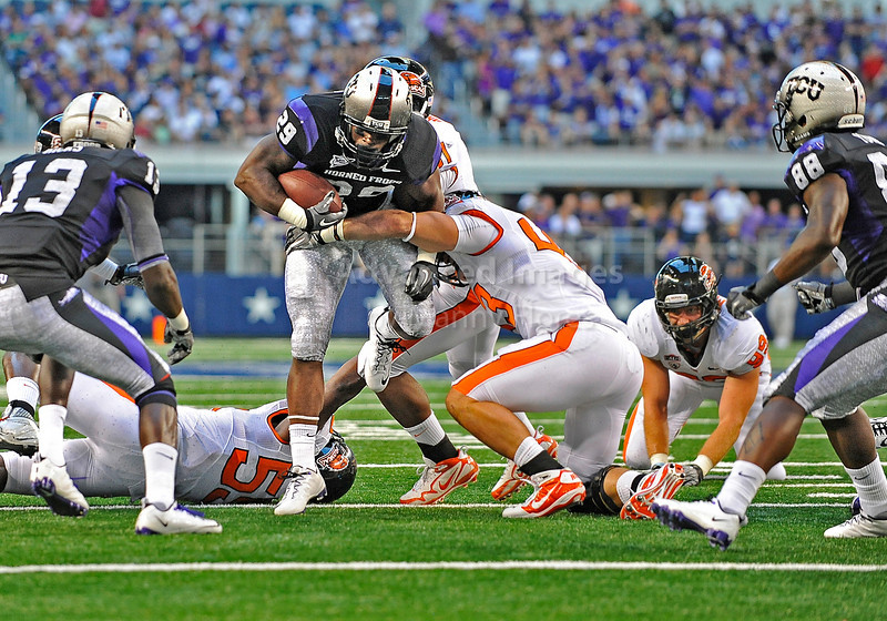 04 Sept 2010:  <br /> TCU Horned Frogs running back Matthew Tucker #29 is tackled by Oregon State Beavers linebacker Tony Wilson #43<br /> in a game between the Oregon State Beavers vs TCU Horned Frogs at Cowboy Stadium in Arlington Texas.<br /> TCU wins 30-21