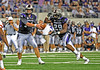 04 Sept 2010:  <br /> TCU Horned Frogs quarterback Andy Dalton #14 hands the ball off to TCU Horned Frogs running back Matthew Tucker #29<br /> in a game between the Oregon State Beavers vs TCU Horned Frogs at Cowboy Stadium in Arlington Texas.<br /> TCU wins 30-21