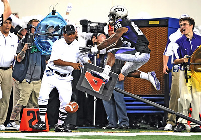 Sept 4 2010:   TCU Horned Frogs wide receiver Jeremy Kerley #85 is forced out of bounds by Oregon State Beavers punter Johnny Hekker #7 in a game between Oregon State Beavers vs Texas Christian University Frogs at Cowboys Stadium in Arlington, Texas. TCU wins 30-21 (Credit Image: © Manny Flores/Cal Sport Media)