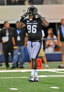 Sept 4 2010:   TCU Horned Frogs defensive end Wayne Daniels #96 puts his helmet on in a game between Oregon State Beavers vs Texas Christian University Frogs at Cowboys Stadium in Arlington, Texas. TCU wins 30-21 (Credit Image: © Manny Flores/Cal Sport Media)