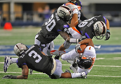Sept 4 2010:   Oregon State Beavers running back Jacquizz Rodgers #1 is hit hard by TCU Horned Frogs safety Tejay Johnson #3 and TCU Horned Frogs safety Colin Jones #28 in a game between Oregon State Beavers vs Texas Christian University Frogs at Cowboys Stadium in Arlington, Texas. TCU wins 30-21 (Credit Image: © Manny Flores/Cal Sport Media)