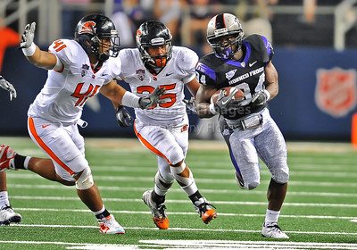 Sept 4 2010:   TCU Horned Frogs running back Ed Wesley #34 carries the ball and tries to run away from Oregon State Beavers linebacker Feti Unga #41 in a game between Oregon State Beavers vs Texas Christian University Frogs at Cowboys Stadium in Arlington, Texas. TCU wins 30-21 (Credit Image: © Manny Flores/Cal Sport Media)