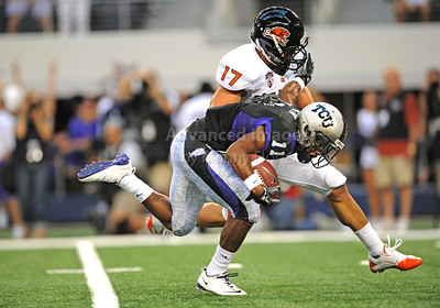 Sept 4 2010:   TCU Horned Frogs wide receiver Skye Dawson #11 stiff arms Oregon State Beavers cornerback Brandon Hardin #17 in a game between Oregon State Beavers vs Texas Christian University Frogs at Cowboys Stadium in Arlington, Texas. TCU wins 30-21 (Credit Image: © Manny Flores/Cal Sport Media)
