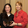 Princeton coach Gail Ramsay presents the 2011 Most Improved Team Award to Columbia captain Anne Cheng