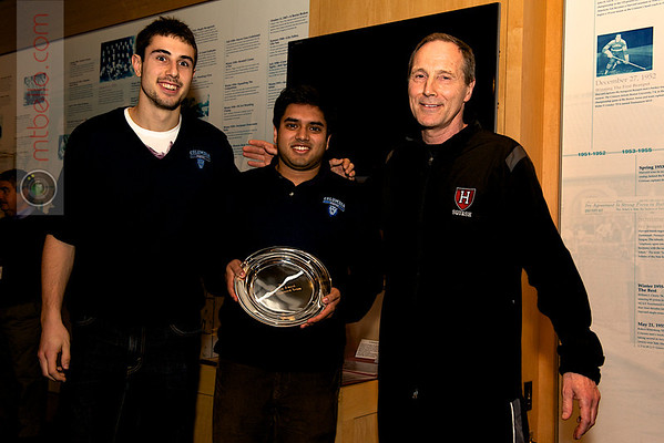 Clayton Dahlman (Columbia), Zach Ali (Columbia), and Mike Way (Harvard) with the most improved team trophy.