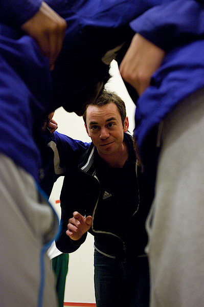 Andrew Mount (Western Ontario) addresses the team prior to the Dartmouth match
