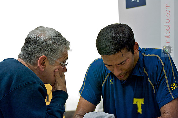 Paul Assaiante talks with Baset Chaudhry moments after the win.