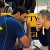 Paul Assiante talks with Baset Chaudhry after the match