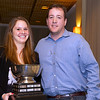 Harvard Asst. Coach Chris Smith present the Barhite Award (best dual match team record) to Yale captain Logan Greer
