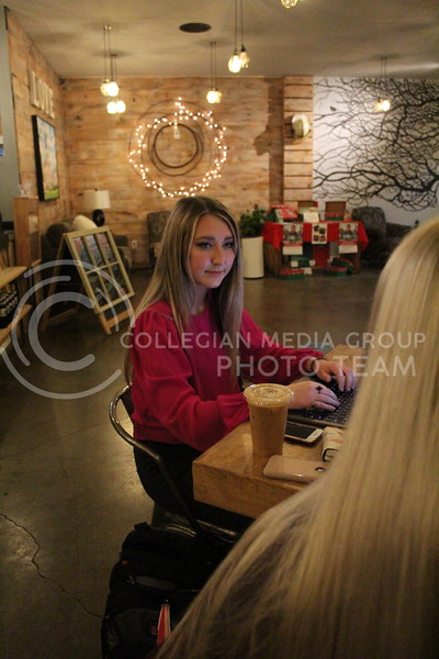 In full focus, sophomore Anderson Jackson interviews two girls for school at a local coffee shop. Jackson is majoring in Mass Communications. Wednesday, November 9, 2020. (Jordan Henington | Collegian Media Group)