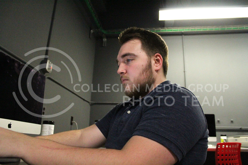 On the computer, junior Matthew Hutley works on his current project. Hutley is a current Graphic Design major in the college of Art and Sciences. Wednesday, November 4, 2020. (Jordan Henington | Collegian Media Group)