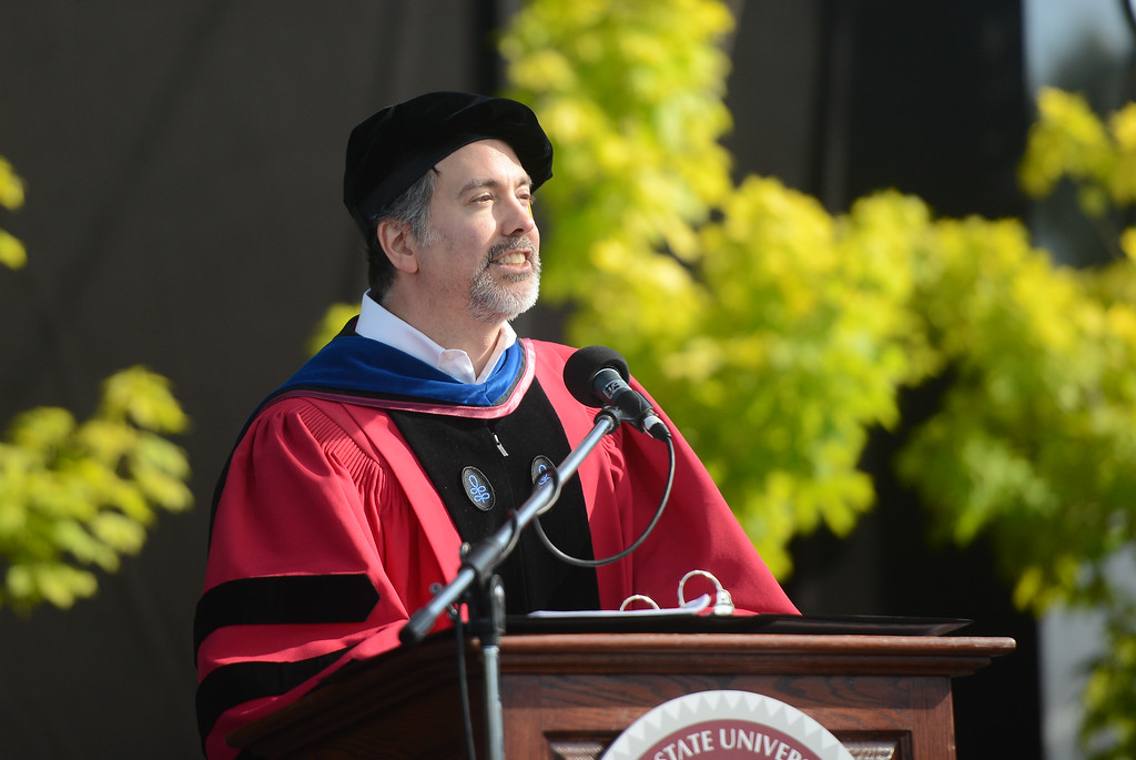 . Jed Wyrich gives a faculty greeting during the Chico State University College of Natural Sciences and College of Engineering, Computer Science & Construction Management Commencement, May 19, 2018,  in Chico, California. (Carin Dorghalli -- Enterprise-Record)
