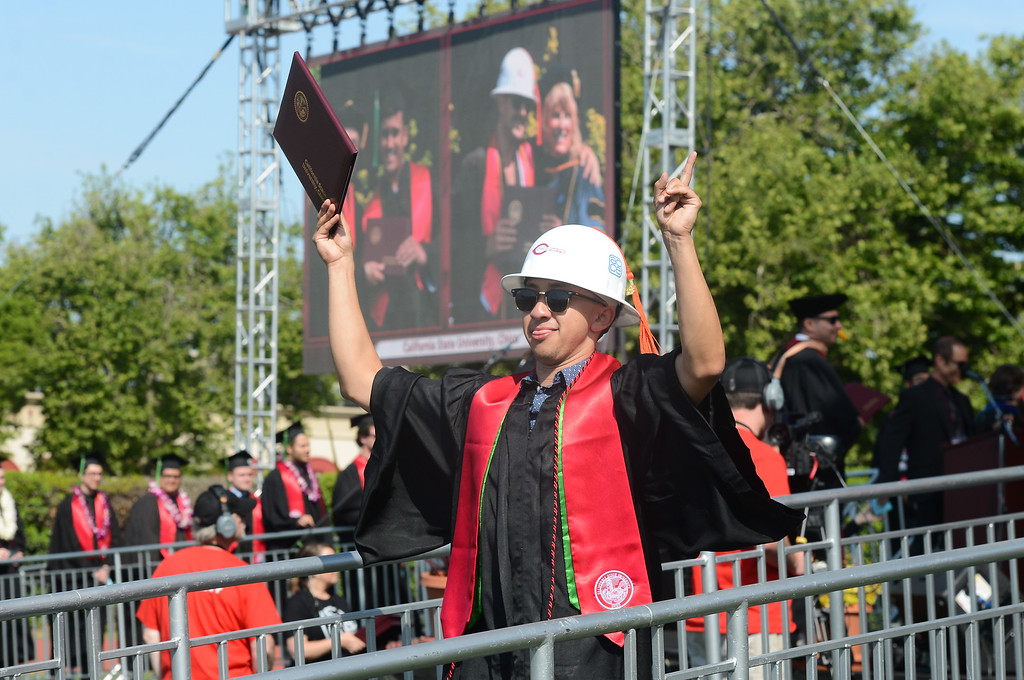 . Josh Gonzalez celebrates during the Chico State University College of Natural Sciences and College of Engineering, Computer Science & Construction Management Commencement, May 19, 2018,  in Chico, California. (Carin Dorghalli -- Enterprise-Record)
