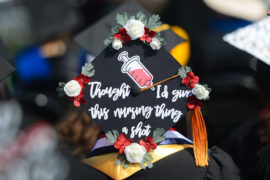 . A nursing student decorates her cap for the Chico State University College of Natural Sciences and College of Engineering, Computer Science & Construction Management Commencement, May 19, 2018,  in Chico, California. (Carin Dorghalli -- Enterprise-Record)