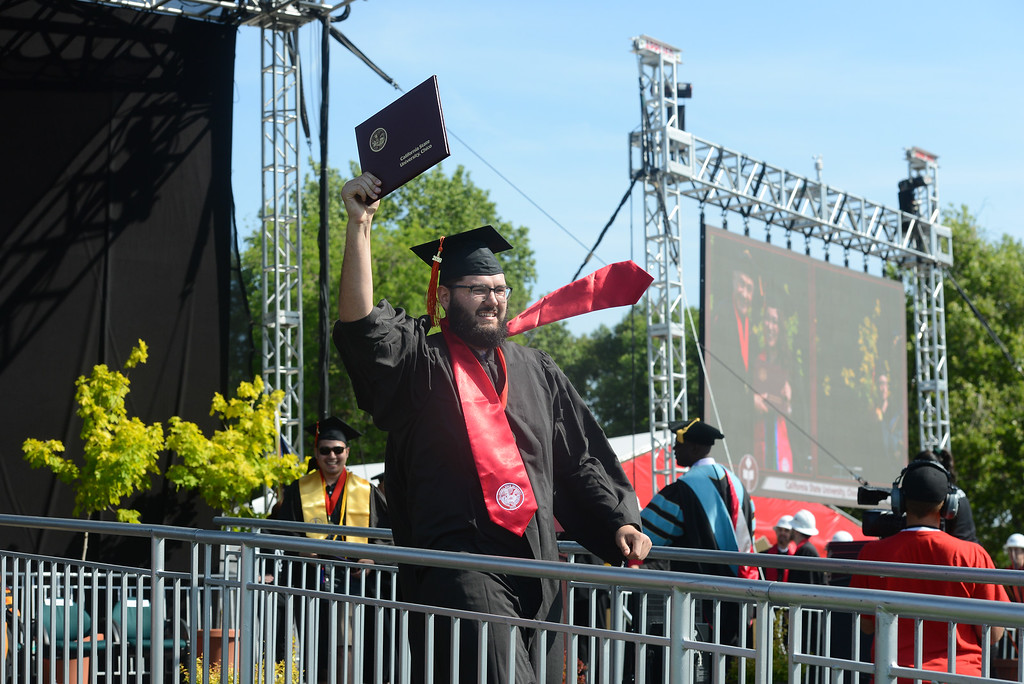 . Aaron Lee celebrates during the Chico State University College of Natural Sciences and College of Engineering, Computer Science & Construction Management Commencement, May 19, 2018,  in Chico, California. (Carin Dorghalli -- Enterprise-Record)