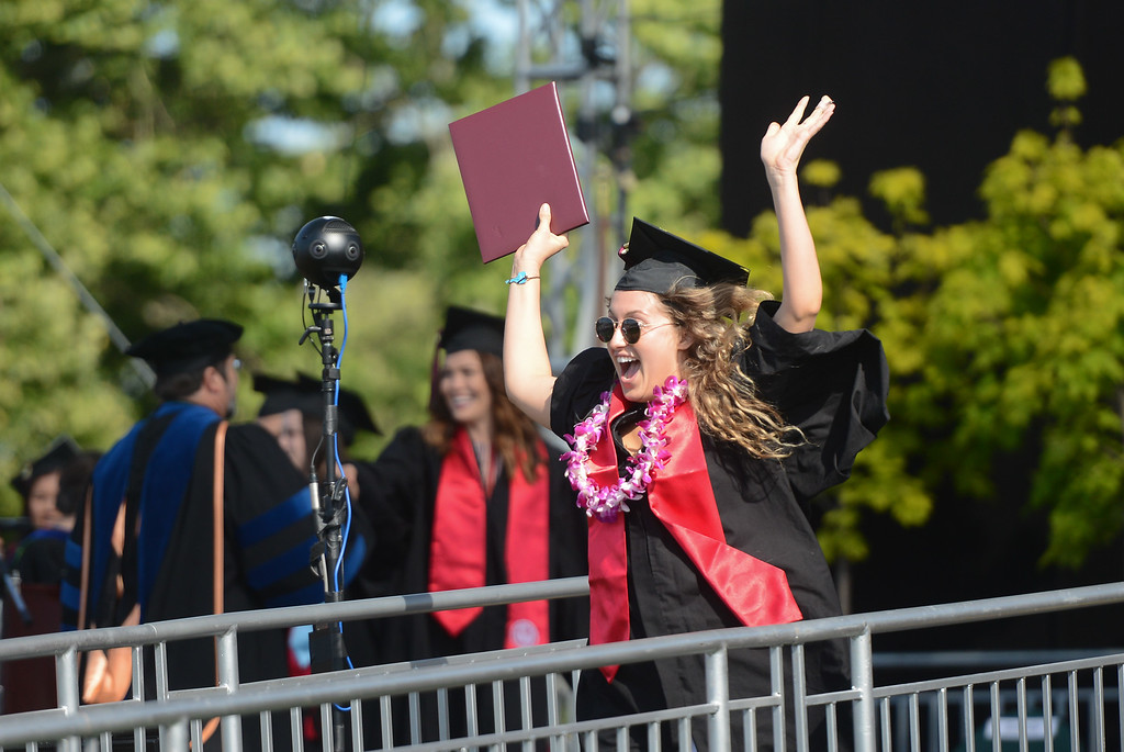 . Madison Steele celebrates during the Chico State University College of Natural Sciences and College of Engineering, Computer Science & Construction Management Commencement, May 19, 2018,  in Chico, California. (Carin Dorghalli -- Enterprise-Record)