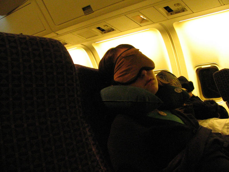 Carlena catching zzzs on the plane.