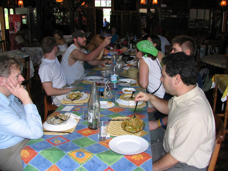 The group at the table for food near the bungalos