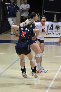 Allison Copp, Morgan Foley and Briana Adviento celebrate a point