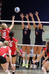 Kaitlin Dunaway and Kristyn Casalino try to block Fresno City's Madison Rinehart